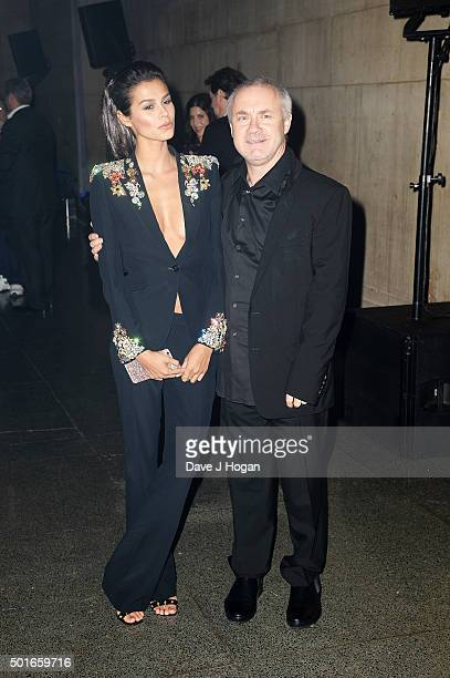 Damien Hirst and a guest attend the European Premiere of 'Star Wars The Force Awakens' After Party at Tate Britain on December 16 2015 in London...
