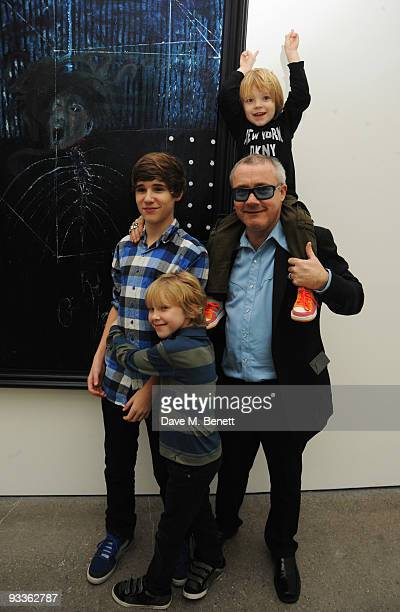 Damien Hirst and his sons attend the private view of his latest exhibition 'Nothing Matters' at the White Cube Gallery on November 24 2009 in London...