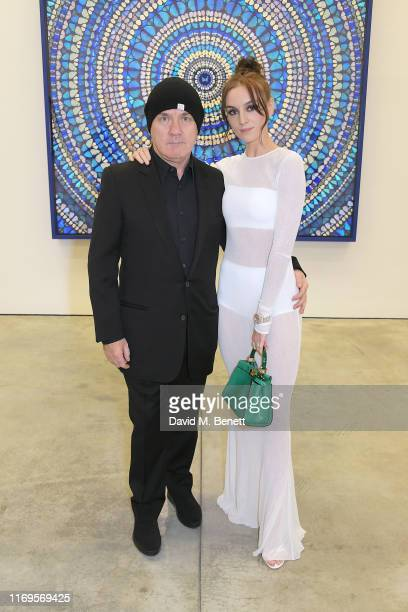 Damien Hirst and Sophie Cannell attend a private view of Damien Hirst Mandalas at White Cube Gallery on September 19 2019 in London England