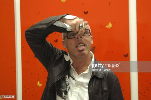 Damien Hirst gestures as he attends his 'A Thousand Years and Triptychs' private view at the Gagosian Gallery on June 20 2006 in London England