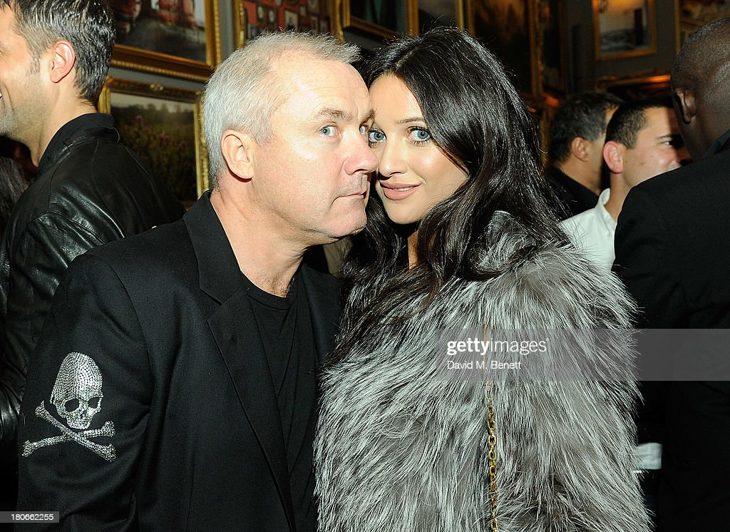 Damien Hirst with guest attends The London Edition opening celebrating the September issue of W Magazine at The London Edition Hotel on September 14, 2013 in London, England.