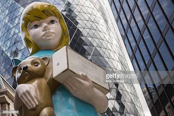 Damien Hirst's sculpture 'Charity' opposite the Gherkin building on July 16 2015 in London England 'Charity' is a 22foot bronze sculpture based on...