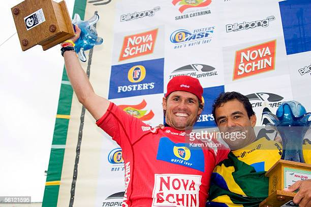 Damien Hobgood celebrates his first place win with runner up Victor Ribas of Brazil at the Nova Schin Festival on November 8 2005 in Imbituba Brazil