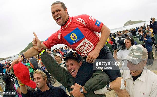 Damien Hobgood is carried up the beach by friends after he clinched the Nova Schin Festival on November 8 2005 in Imbituba Brazil