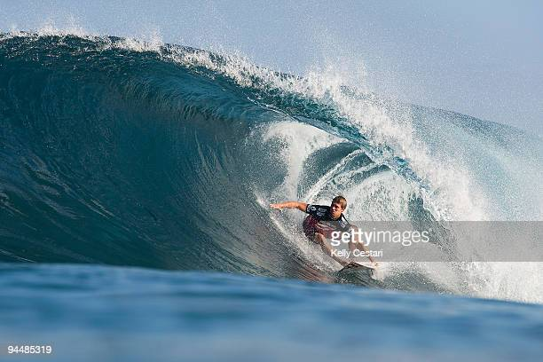 Damien Hobgood of the United States surfs on his way to elimination in the Quarter Finals of the Billabong Pipeline Masters on December 15 2009 at...
