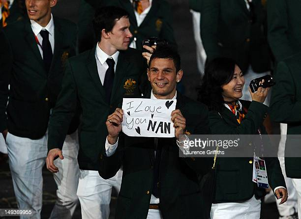 Damien Hooper of Australia displays the message 'I love you Nan' as he parades around the stadium with the rest of the Australia team during the...