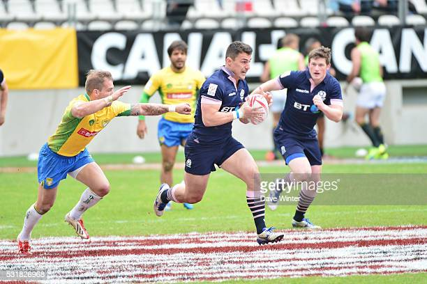 Damien Hoyland of Scotland makes a break during the HSBC PARIS SEVENS tournament at Stade Jean Bouin on May 15 2016 in Paris France