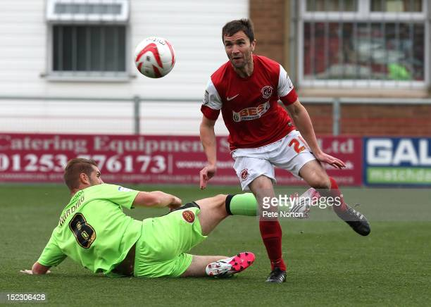 Damien Johnson of Fleetwood Town moves past the challenge of Ben Harding of Northampton Town during the npower League Two match between Fleetwood...