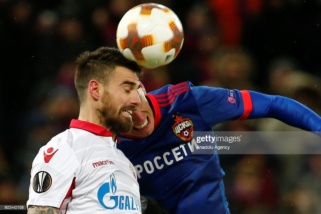 Damien Le Tallec (L) of Crvena Zvezda in action against Pontus Wernbloom (R) of CSKA Moscow during the UEFA Europa League round of 32, second leg soccer match between CSKA Moscow and Crvena Zvezda at the Stadium CSKA Moscow in Moscow, Russia on February 21, 2018.