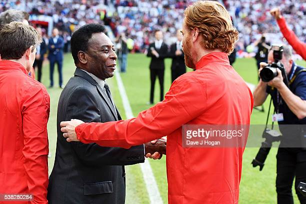 Damien Lewis greets Pele during Soccer Aid at Old Trafford on June 5, 2016 in Manchester, England.