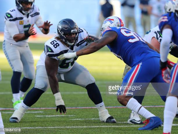 Damien Lewis of the Seattle Seahawks looks to make a block against the Buffalo Bills at Bills Stadium on November 8, 2020 in Orchard Park, New York.