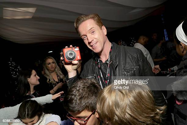 Damien Lewis poses with the Instax Mini 70 at Z100's artist gift lounge during Jingle Ball 2016 at Madison Square Garden on December 9 2016 in New...