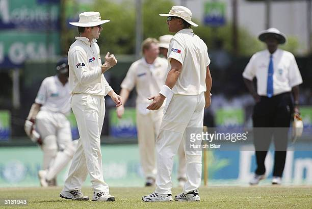 Damien Martyn and Shane Warne of Australia discuss an incident that lead to the third umpire being called to investigate an appeal for hit wicket...