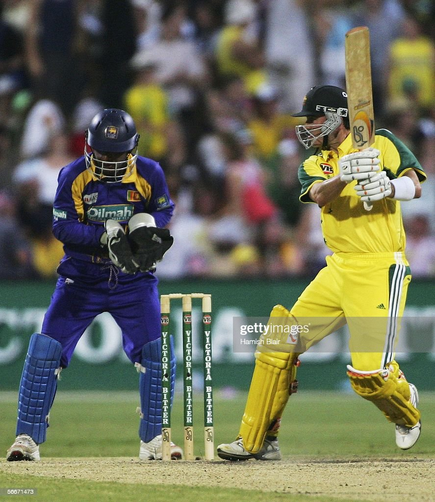 Damien Martyn of Australia in action with Kumar Sangakkara of Sri Lanka looking on during Game 7 of the VB Series between Australia and Sri Lanka played at the Adelaide Oval on January 26, 2006 in Adelaide, Australia.