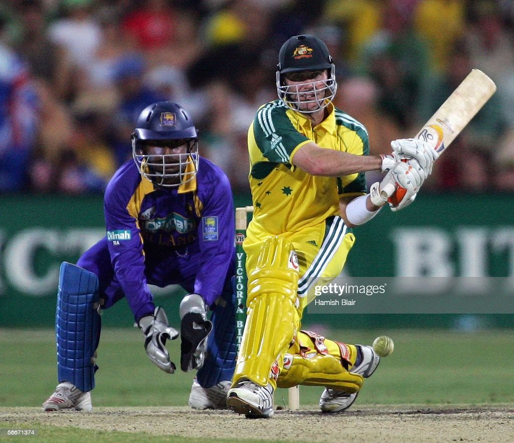 Damien Martyn of Australia reverse sweeps with Kumar Sangakkara of Sri Lanka looking on during Game 7 of the VB Series between Australia and Sri Lanka played at the Adelaide Oval on January 26, 2006 in Adelaide, Australia.