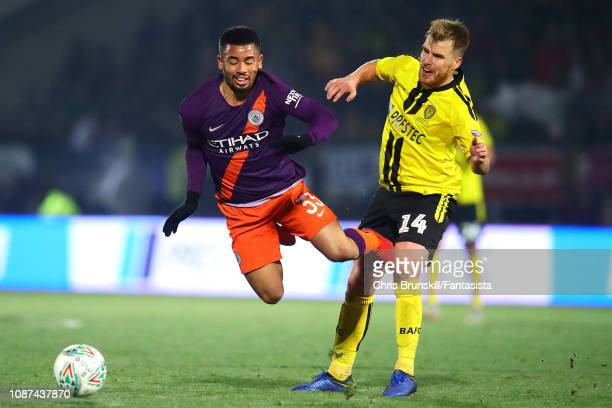 Damien McCrory of Burton Albion fouls Gabriel Jesus of Manchester City during the Carabao Cup Semi Final Second Leg match between Burton Albion and...