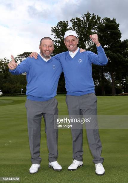 Damien McGrane and David Higgins celebrate after the the singles matches on the final day of the 28th PGA Cup at Foxhills Golf Course on September 17...