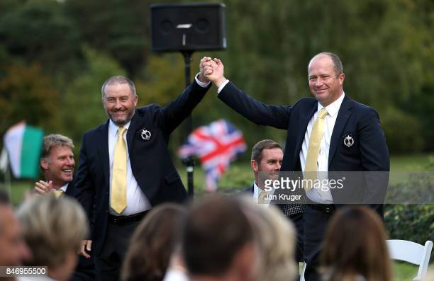 Damien McGrane and Greig Hutcheon of the Great Britain and Ireland PGA Cup team are announced as the opening pairing during the opening ceremony...