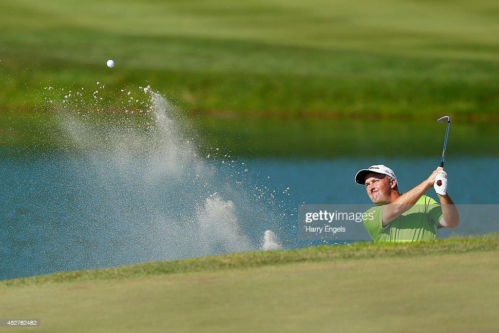 Damien McGrane of Ireland hits out of a bunker at the eighteenth on day four of the M2M Russian Open at Tseleevo Golf & Polo Club on July 27, 2014 in Moscow, Russia.