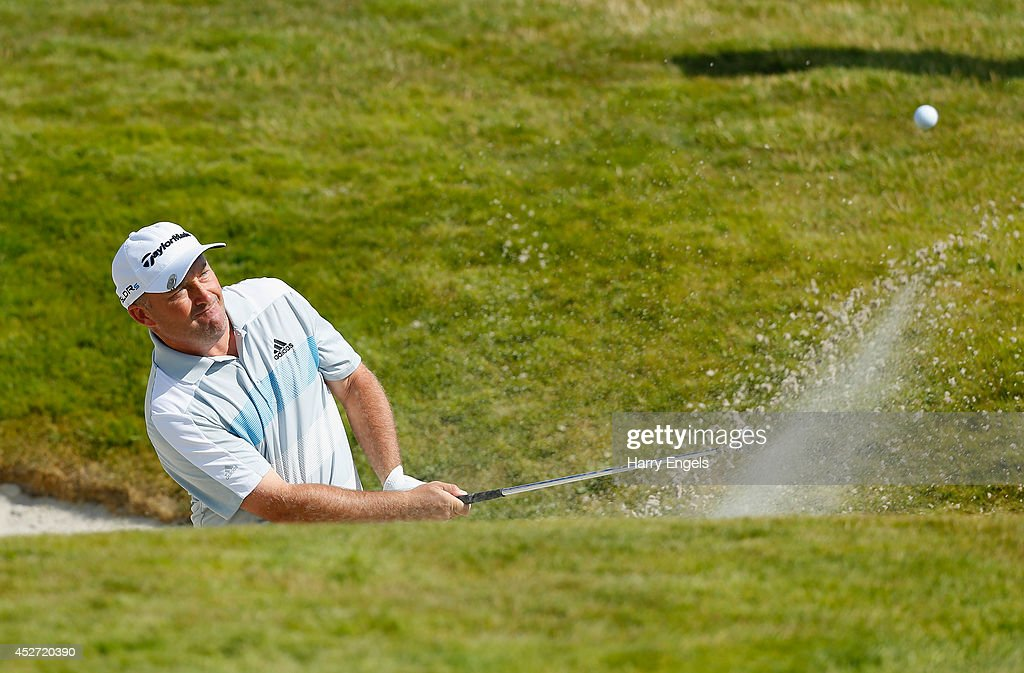 Damien McGrane of Ireland plays out of a bunker at the first on day three of the M2M Russian Open at Tseleevo Golf & Polo Club on July 26, 2014 in Moscow, Russia.