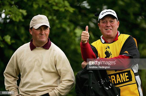 Damien McGrane of Ireland stands with his caddy Edinburgh Jimmy Rae on the 18th hole during the first round of The Johnnie Walker Championship at...