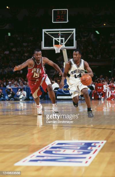 Damien McKnight, Guard for the Penn State Nittany Lions dribbles past Marlon Towns, Guard for the University of Arkansas Razorbacks during their NCAA...