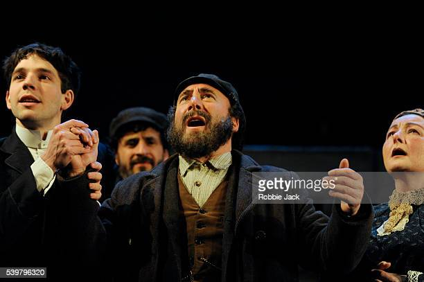 Damien Molony as Moti, Antony Sher as Jacob Bindel and Abigail McKern as Ida with artists of the company in Nicholas Wright's Travelling Light...