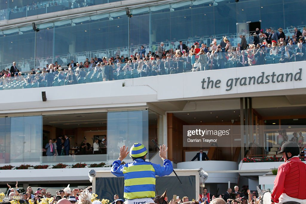 Damien Oliver acknowledges the crowd after riding Jameka to win race 8, the Crown Oaks on Oaks Day at Flemington Racecourse on November 5, 2015 in Melbourne, Australia.