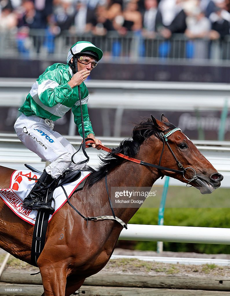 Damien Oliver blows a kiss after winning on Fiveanfahalfstar after winning the Victoria Derby during Victoria Derby Day at Flemington Racecourse on November 3, 2012 in Melbourne, Australia.