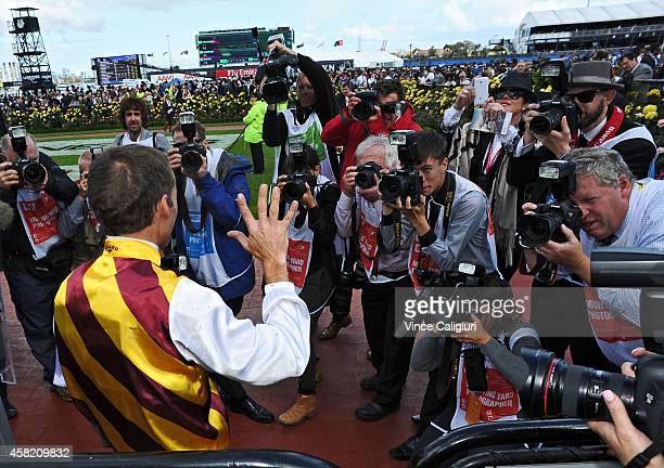 Damien Oliver poses for a photo after Preferment won Race 7 the AAMII Victoria Derby during Derby Day at Flemington Racecourse on November 1 2014 in...