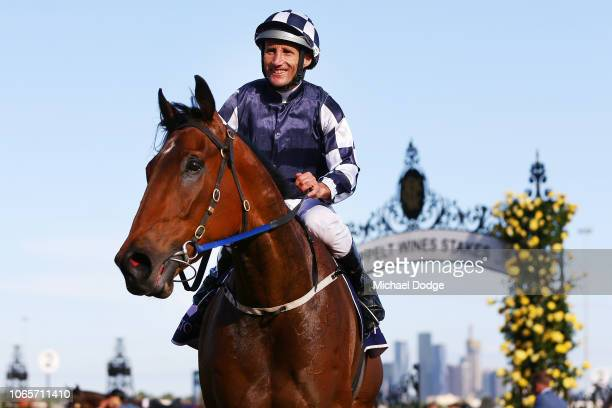 Damien Oliver returns to the mounting yard on Order of Command after winning the Grand Handicap at Flemington Racecourseduring Stakes Day at...