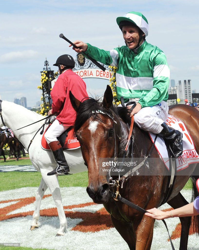 Damien Oliver riding Fiveandahalfstar celebrates winning the AAMI Victoria Derby during Victorian Derby Day at Flemington Racecourse on November 3, 2012 in Melbourne, Australia.