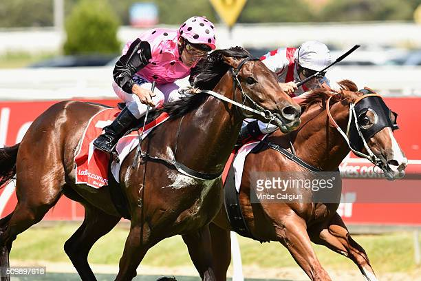 Damien Oliver riding Flying Artie defeats Dwayne Dunn riding Star Turn in Race 4 Blue Diamond Prelude during Melbourne Racing at Caulfield Racecourse...