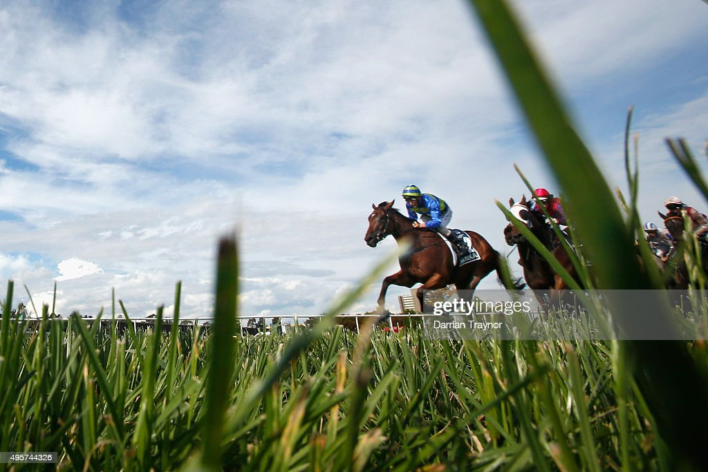 Damien Oliver riding Jameka leads to field onto the straight during race 8, the Crown Oaks on Oaks Day at Flemington Racecourse on November 5, 2015 in Melbourne, Australia.