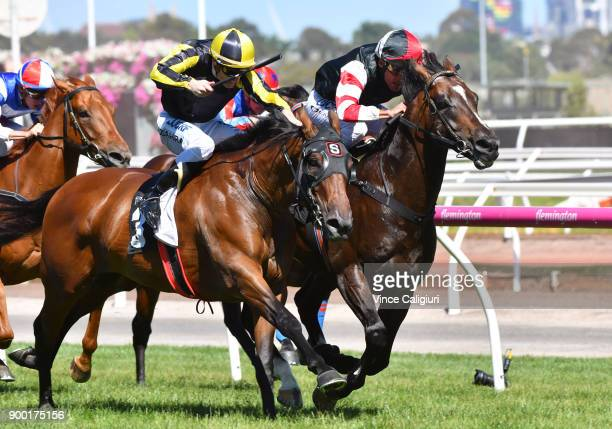 Damien Oliver riding Lord of the Sky defeats Mark Zahra riding Flippant in Race 6 the Standish Handicap during Melbourne Racing at Flemington...