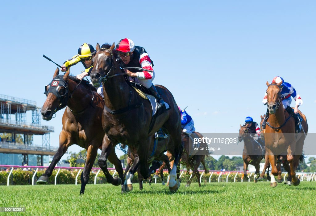 Damien Oliver riding Lord of the Sky defeats Mark Zahra riding Flippant in Race 6, the Standish Handicap during Melbourne Racing at Flemington Racecourse on January 1, 2018 in Melbourne, Australia.