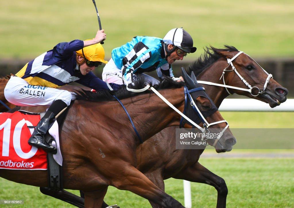 Damien Oliver riding Mutarakem defeats Ben Allen riding Savvy Belle in Race 6 during Melbourne Racing at Sandown Hillside on January 10, 2018 in Melbourne, Australia.