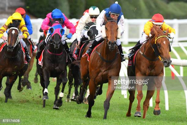 Damien Oliver riding Pearl De Vere defeats Noel Callow riding Masipag in Race 1 during Melbourne Racing at Moonee Valley Racecourse on November 17...