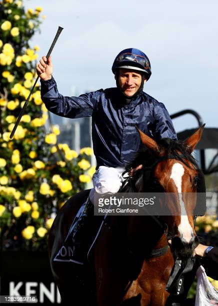 Damien Oliver riding Personal celebrates winning race eight the Kennedy Oaks during 2020 Kennedy Oaks Day at Flemington Racecourse on November 05,...