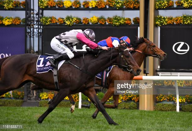 Damien Oliver riding Steel Prince defeats Dean Holland riding Surprise Baby in Race 8 The Andrew Ramsden during Melbourne Racing at Flemington...