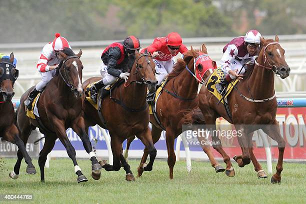 Damien Oliver riding Trust in a Gust wins Race 5 during Melbourne Racing at Caulfield Racecourse on January 4 2014 in Melbourne Australia