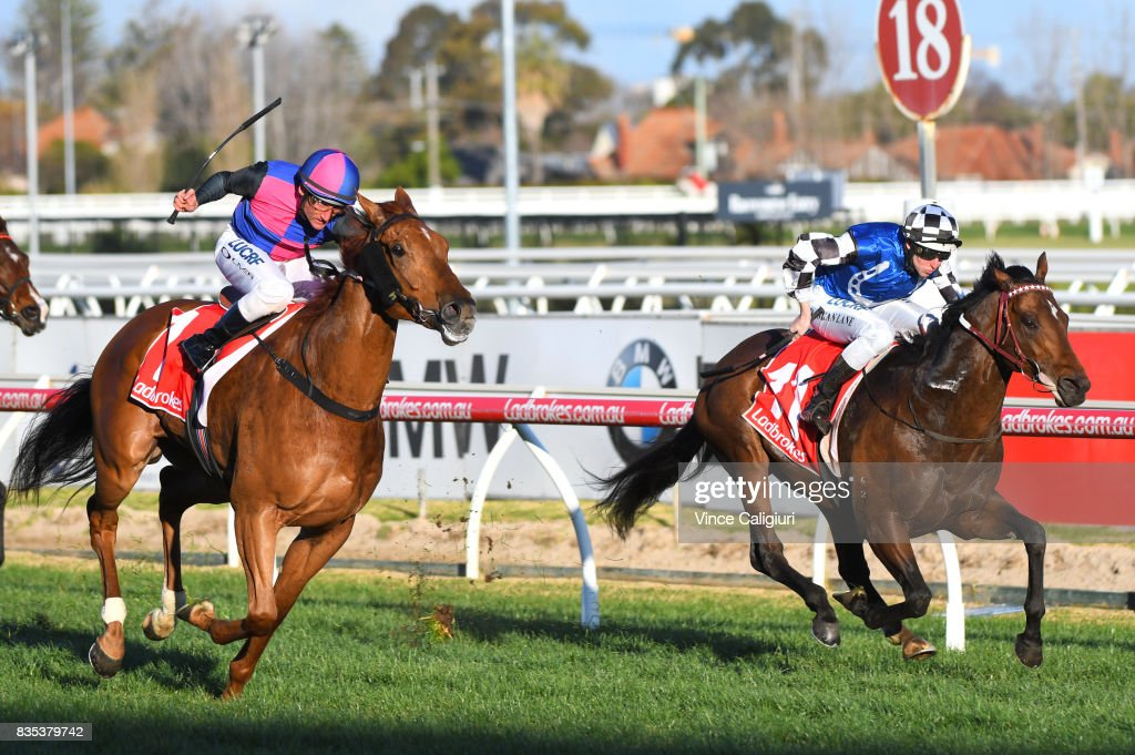 Damien Oliver riding Vega Magic defeats Damian Lane riding Brave Smash (r) during Melbourne Racing at Caulfield Racecourse on August 19, 2017 in Melbourne, Australia.