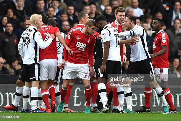 Damien Perquis of Nottingham Forest and Darren Bent of Derby County clash during the Sky Bet Championship match between Derby County and Nottingham...