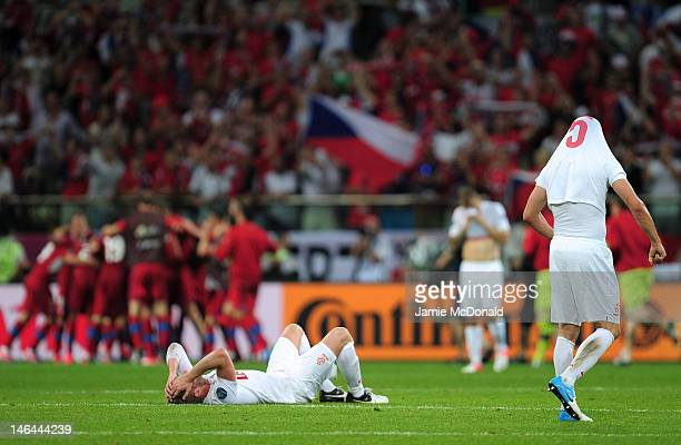 Damien Perquis of Poland lies on the pitch at the final whistle during the UEFA EURO 2012 group A match between Czech Republic and Poland at The...