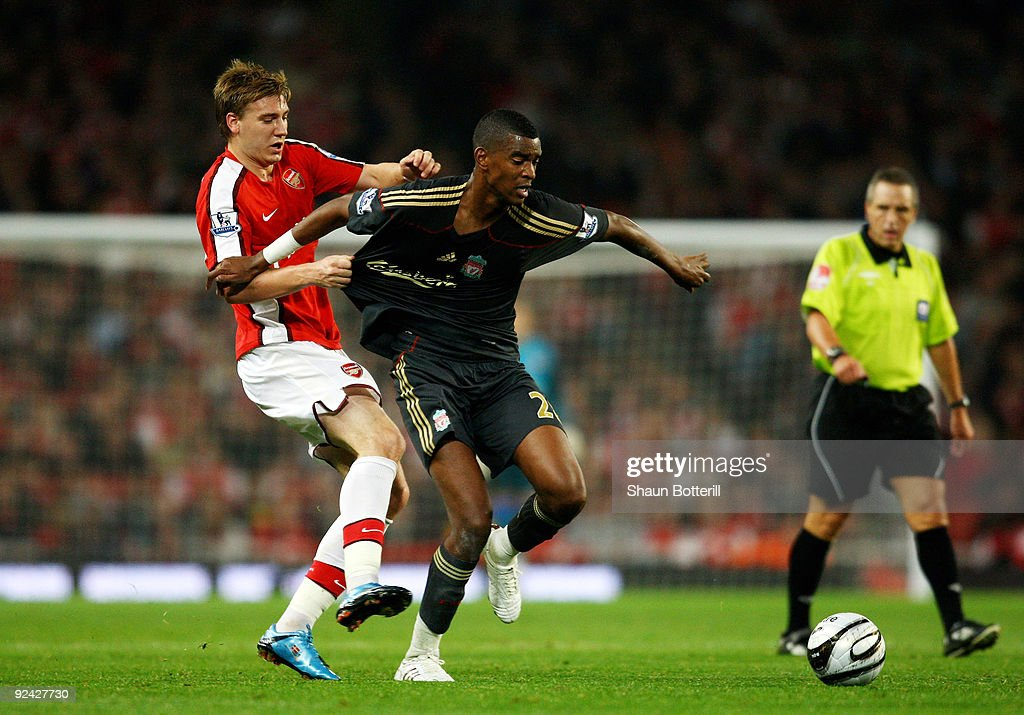 Damien Plessis of Liverpool is challenged by Nicklas Bendtner of Arsenal during the Carling Cup 4th Round match between Arsenal and Liverpool at the Emirates Stadium on October 28, 2009 in London, England.