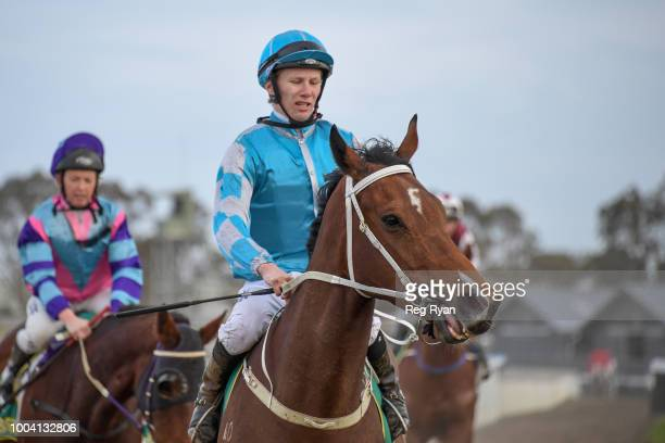 Damien Thornton returns to the mounting yard on Cerebellum after winning the Geelong Homes FM Maiden Plate at Geelong Synthetic Racecourse on July 23...