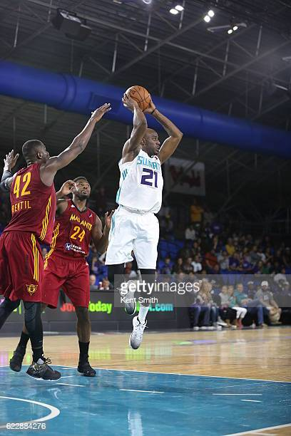 Damien Wilkins of the Greensboro Swarm looks to pass the ball against Ben Bentil of the Fort Wayne Mad Ants during the game at the The Field House at...