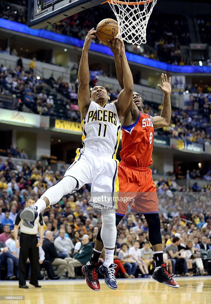 Damien Wilkins #8 of the Philadelphia 76ers and Orlando Johnson #11 of the Indiana Pacers reach for a rebound during the game at Bankers Life Fieldhouse on April 17, 2013 in Indianapolis, Indiana.NOTE