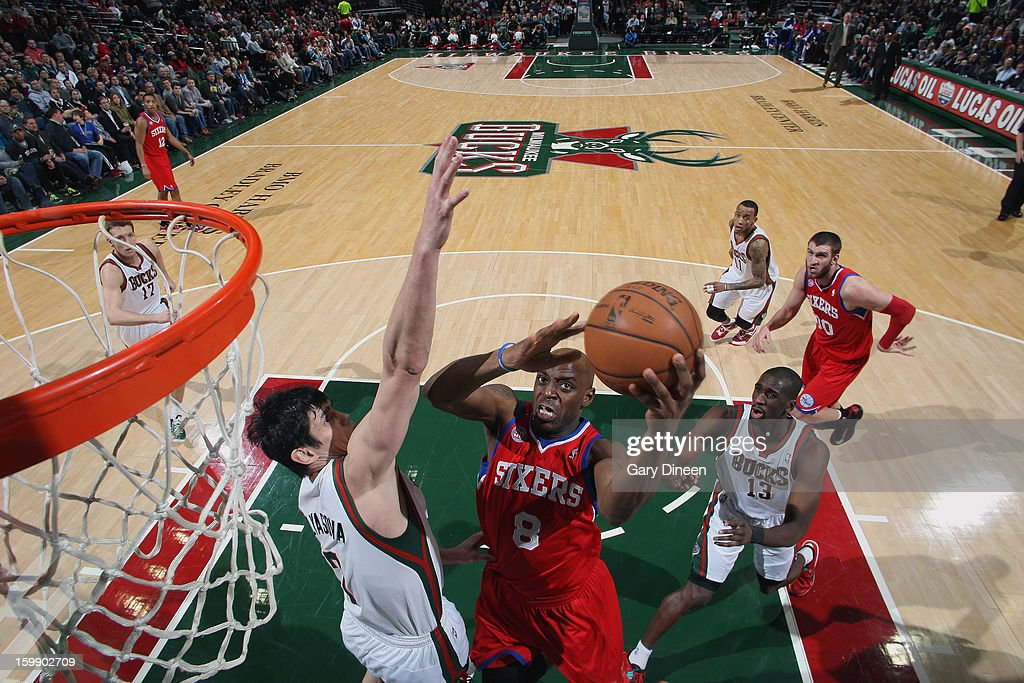 Damien Wilkins #8 of the Philadelphia 76ers shoots against (L-R) Ersan Ilyasova #7 and Ekpe Udoh #13 of the Milwaukee Bucks on January 22, 2013 at the BMO Harris Bradley Center in Milwaukee, Wisconsin.