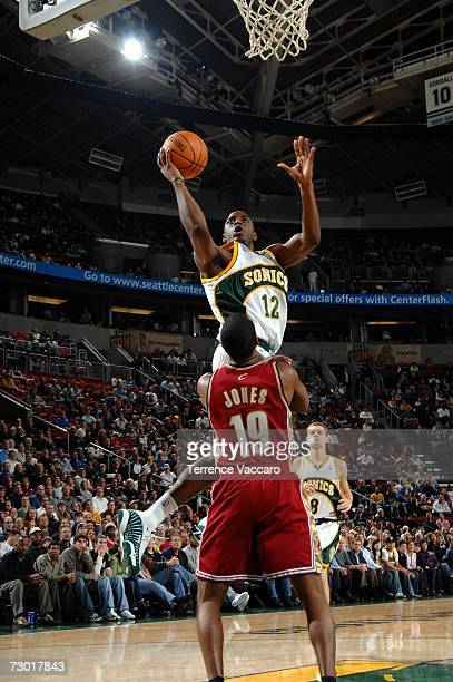 Damien Wilkins of the Seattle SuperSonics goes to the basket over the defense of Damon Jones of the Cleveland Cavaliers on January 16 2007 at the Key...
